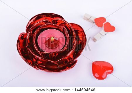 Red candle candlestick and hearts on white background