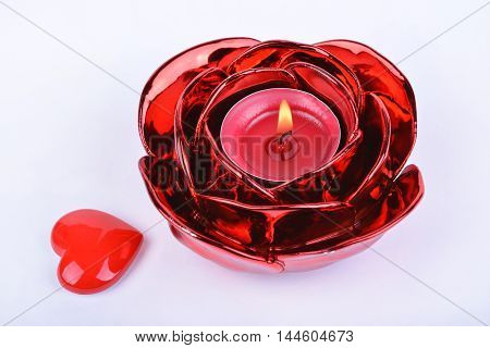 Red candle candlestick and heart on white background