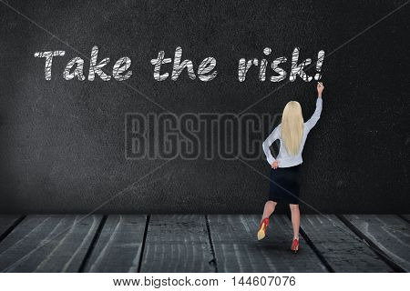 Take the risk text write on black board
