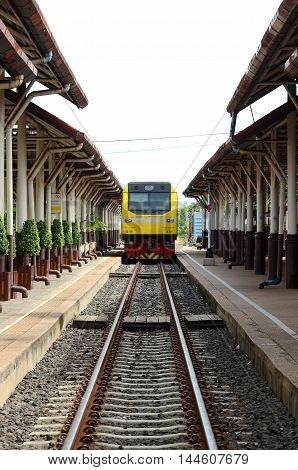 The train was parked in a railway station in Thailand.