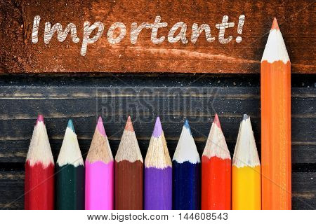 Important text and group of pencil on wooden table
