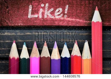 Like text and group of pencil on wooden table