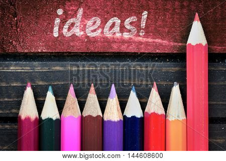 Ideas text and group of pencil on wooden table