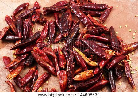 Dried red chilis on a rustic background