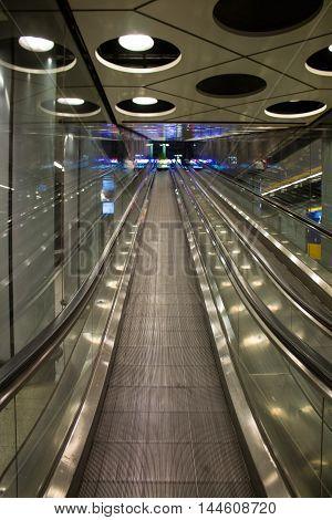 Close up of night illuminated modern escalator.