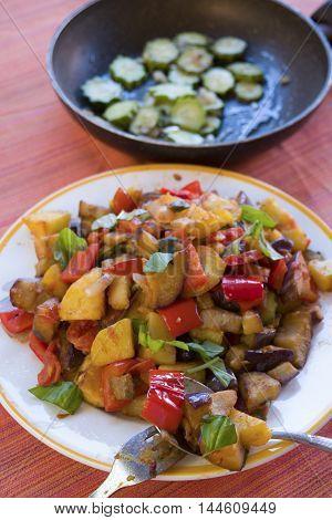 sicilian fried caponata with eggplants tomatoes potatoes and basil