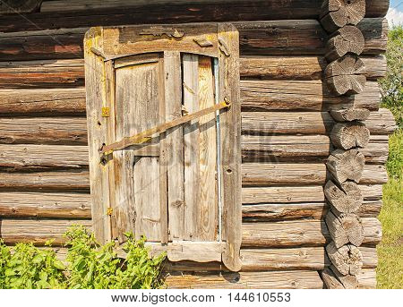 old wooden brown houzsse with closet door on sunny summers day