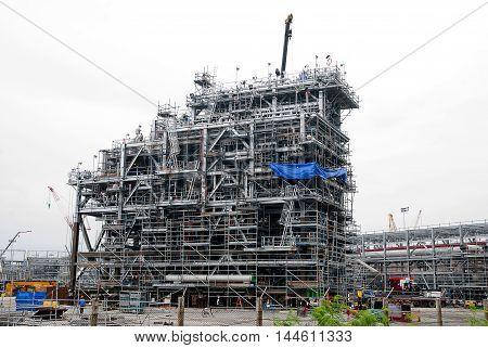 Build Petrochemical Plant.