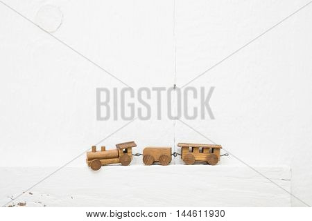 Old white wooden background with a little small handmade train.