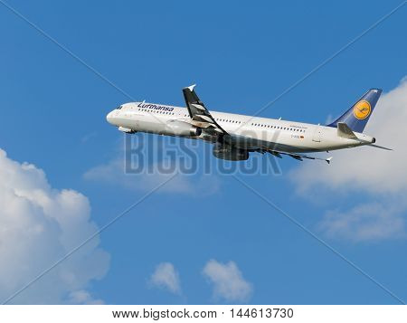 Moscow - July 31 2016: beautiful passenger aircraft Airbus A321-231 Lufthansa flies to Domodedovo airport and on a background of blue sky July 31 2016 Moscow Russia
