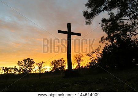 Christian cross sunrise sunset silhouette bush landscape