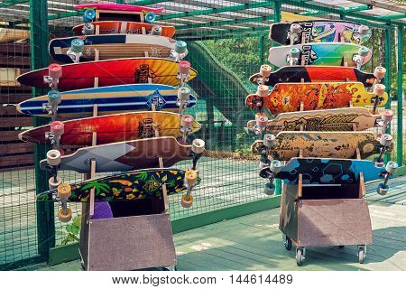 VILNIUS LITHUANIA - MAY 29 2016: Colorful longboards and skateboards for rent in skateboarding park outdoors in Vilnius Lithuania.