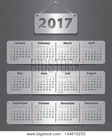 Calendar for 2017 year in English attached with metallic tablets. Vector illustration