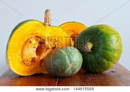 Autumn pumpkins. Set of different pumpkins on wooden surface.