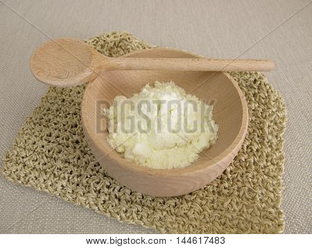 Milk powder in small wooden bowl for milk drink