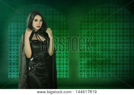 Asian Witch Woman Wearing Black Costume