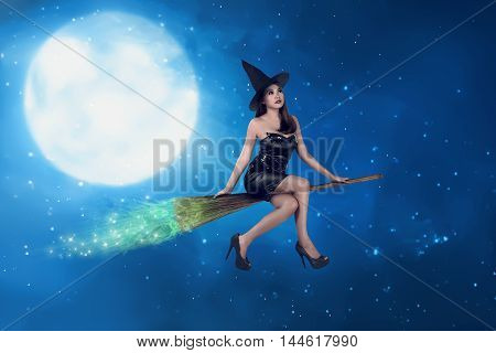Asian Witch Woman Ride The Broom On The Sky