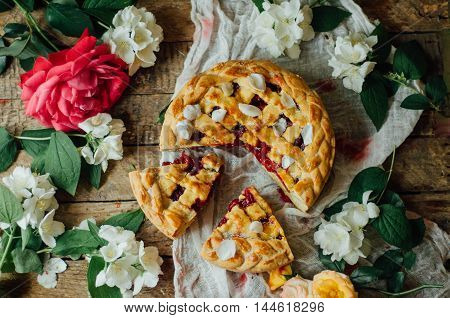 Homemade Cherry And Strawberry  Pie On Rustic Background. Delicious Homemade Cherry Pie With A Flaky