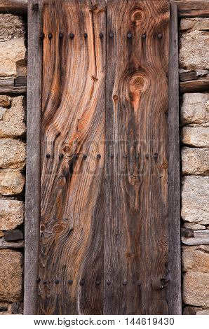 old wooden door in the stone fence