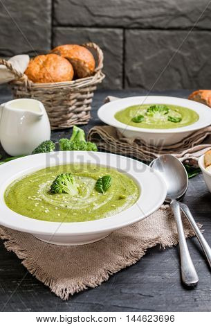 Broccoli cream soup on the black background