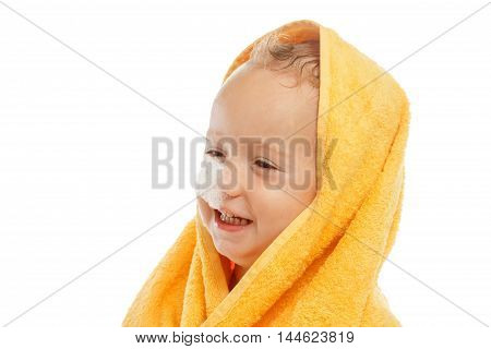 little boy wearing yellow towel sitting after bath or shower isolated on white. Clean dry child in bedroom. Bathing and washing of little kids. Children hygiene. Textile for infants.