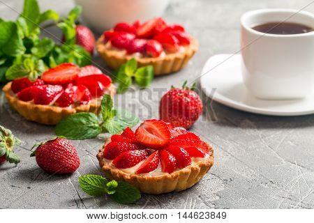 Fresh homemade strawberries tarts  on gray background