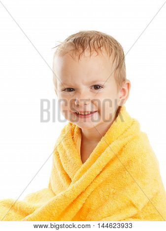 Happy baby wearing yellow towel sitting after bath or shower isolated on white. Children hygiene. Textile for infants.