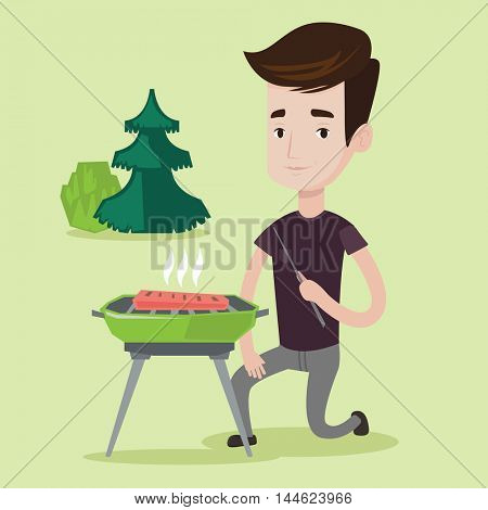 Young man sitting next to barbecue grill in the park. Man cooking meat on the barbecue grill outdoors. Smiling man having a barbecue party. Vector flat design illustration. Square layout.