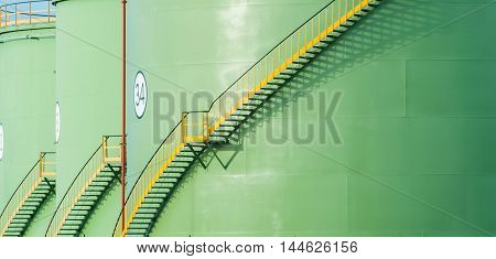 Staircases on green tanks in a refinery