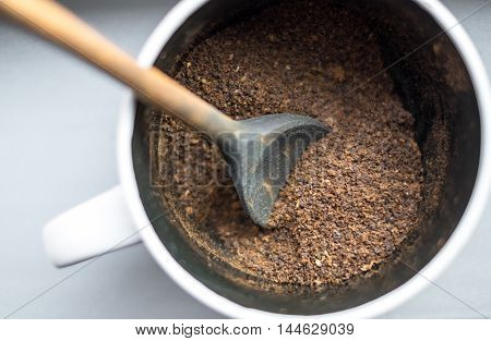 Ground Coffee In A Cup With A Spoon
