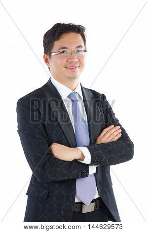 Confident Southeast Asian businessman crossed arms over white background