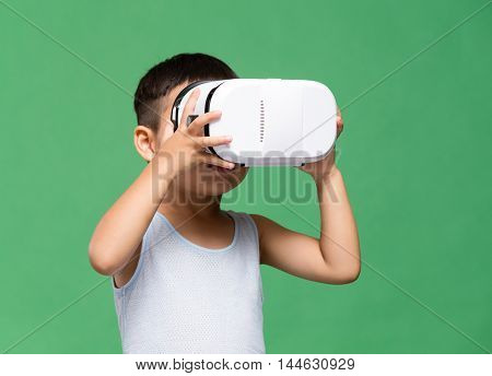 Little boy watching though VR device