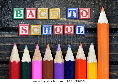 Back to School text and group of pencil on wooden table