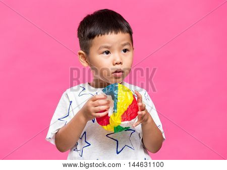 Little boy play with the paper balloon