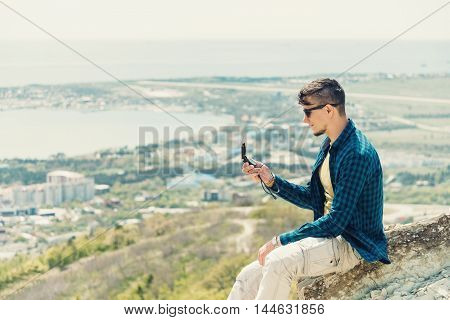 Explorer young man searching direction with a compass in summer outdoor