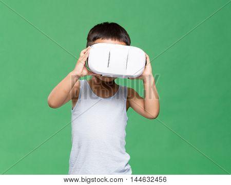 Little kid uisng VR device