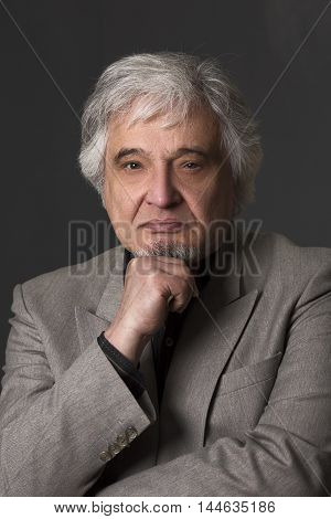 Portrait of professor man of university or colleage in studio. Academic man in business suit looking at camera isolated on black background.