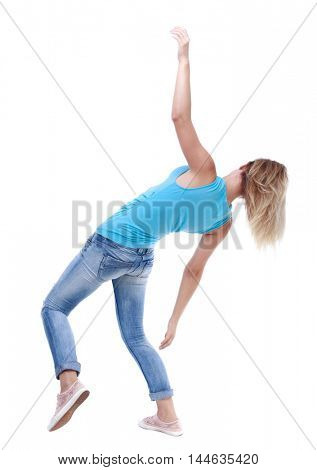 Balancing young woman. or dodge falling woman. Rear view people collection. blonde in a blue shirt and jeans slipped and falls on his back.