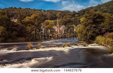 The river Dee and the Llangollen Methodist Church at Llangollen, North Wales, UK.