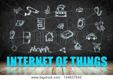Internet of Things (IoT) word on wood floor with doodle icon on blackboard wallTechnology Concept Design. 3d rendering