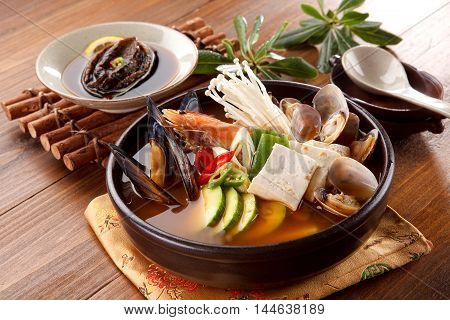 Seafood hot pot of overture jangjeongsik with blue mussel clams shrimp mushroom abalone and herbs