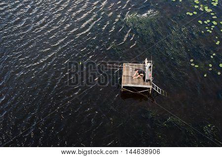 Kiev Ukraine - June 16 2016: Fisherman on the platform top view.