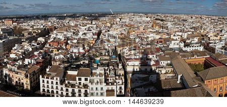 SEVILLE, SPAIN - JANUARY 9, 2016: Panorama of the historical centre of Seville in Andalusia, Spain, pictured from the Giralda bell tower of the Seville Cathedral.