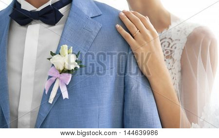 Groom and bride hugging, closeup