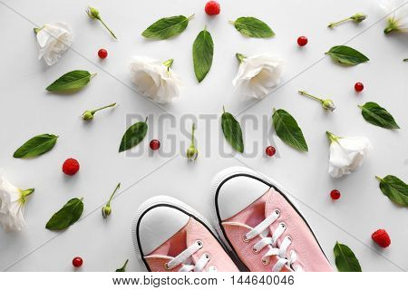 Colorful pattern made of red currants, flower buds and shoes