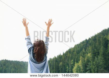 Happy traveler girl in forest