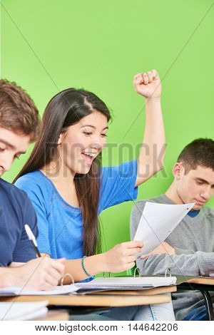 Successful asian student celebrates her test results in class
