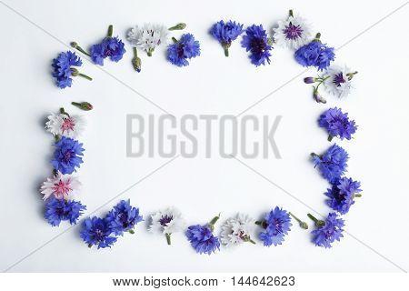 Frame made of bluett flowers isolated on white