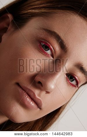 Woman With A Creative Colored Red Lashes