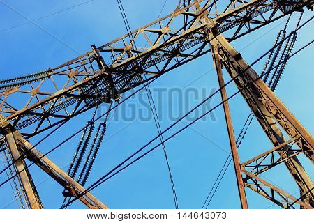powerful metal bearing high voltage transmission line with a path for movement repairmen vertical part on hydroelectric